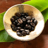 A cup of coffee beans — Stock Photo