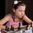 Stock Photo: Girl playing chess
