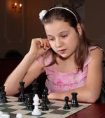 Girl playing chess — Stock Photo