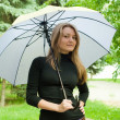 Foto Stock: Girl with umbrella