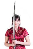 女孩与武士刀 — 图库照片