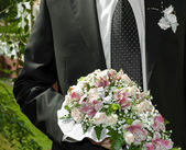 Man with bouquet — Stock Photo