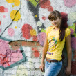 Girl on graffiti background — Stock Photo #4324046