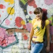 Girl on graffiti background — Stock Photo