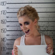 Girl wink in prison - Stock Photo