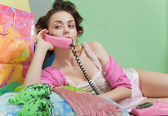 Girl with pink phone — Stock Photo