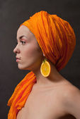 Girl with orange headscarf — Stock Photo