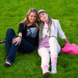 Two beauty girls on grass — Stock Photo