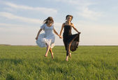 Two girls running on the field 4 — Stock Photo