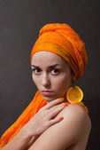 Girl with orange headscarf — Stock Photo