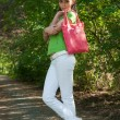 Girl with pink bag — Stock Photo #4982138