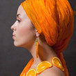 Girl with orange headscarf — Stock Photo #5010791