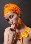 Girl with orange headscarf — Stock fotografie