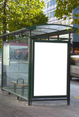 Bus stop with a blank billboard — Stok fotoğraf