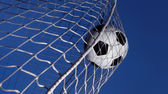 Soccer ball kicked into a goal — Stock Photo