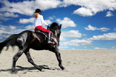 Teenage girl horseback riding — Stock Photo
