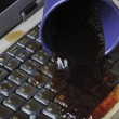 Stock Photo: Coffee spilling on keyboard