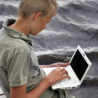 Stock Photo: Boy with a laptop