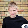 Stock Photo: Boy against wall with ball