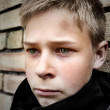 Upset boy leaning against a wall — Stock Photo #4229130