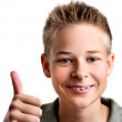Young boy with his thumbs up with joy — Stock Photo #4229150