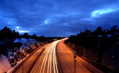 Cars at night with motion blur. — Stockfoto