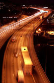 Cars at night with motion blur — Stock Photo