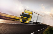 Truck driving on country-road motion — Stock Photo