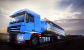 Truck driving at dusk motion blur — Stock Photo