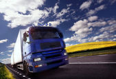 Truck driving at dusk/motion blur — Stock Photo