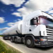 Truck driving on country-road/motion — Stock Photo