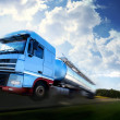 Truck driving on country-road motion - Stock Photo