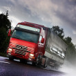 Stock Photo: Truck driving on country-road