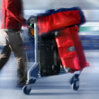 Man with red bags at the airport — Stock Photo