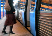 Women boarding a train — Stock Photo