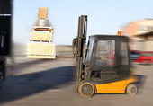 Forklift loading truck — Stock Photo