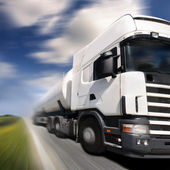 Truck driving on country-road/motion blur — Stock Photo