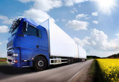 Truck driving on country-road/motion — Foto Stock