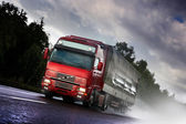 Truck driving on country-road — Stock Photo
