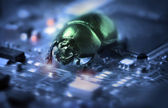 Bug on a computer chip — Stock Photo