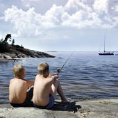 Two boys fishing — Stock Photo