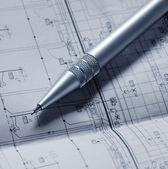 Floorplan and a pen — Stock Photo