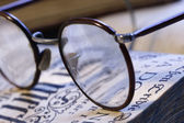 Book and eyeglasses — Stock Photo