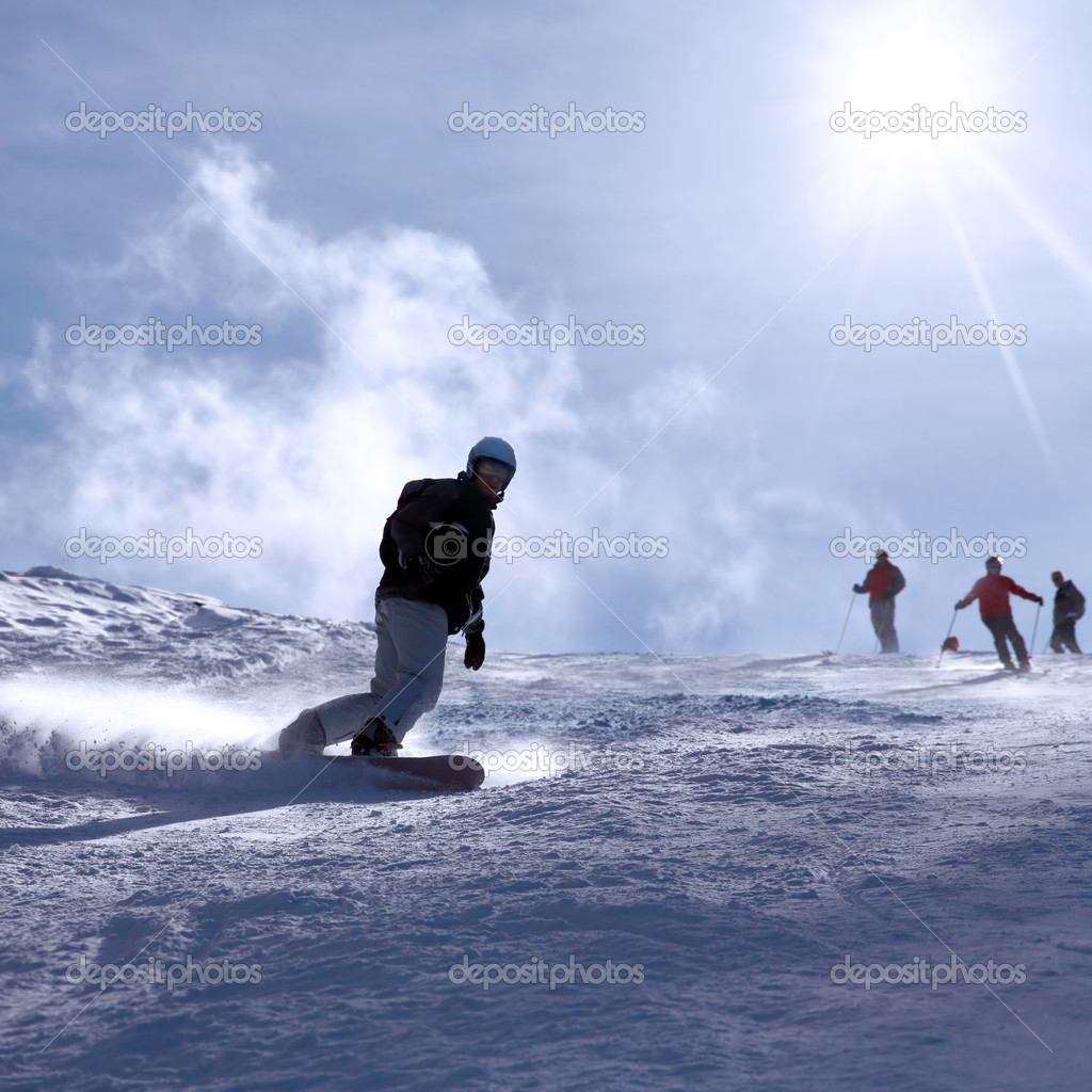 Ski resort Italy , man snowboarding — Stock Photo #4231429