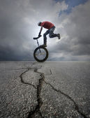 Young man unicycle on the street — Stock Photo