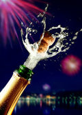 Close up of champagne cork popping — Stok fotoğraf