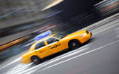 Motion blur image of yellow Taxi — Stock Photo