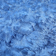 Frost patterns on window glass in winter — Stock Photo