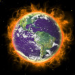 Stock Photo: Real Earth Planet in space. In red fire.