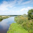 Small blue river surround the green banks. Belarus. — Stock Photo